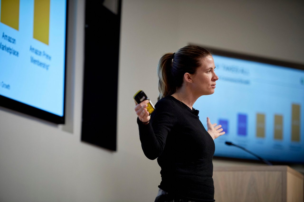 A Women Giving Speech on Digital Strategy That Brands Should Master for International Expansion